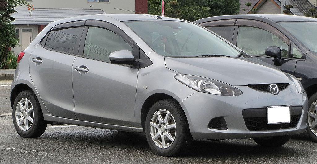 1024px-Mazda_Demio_13C-V_DE3FS
